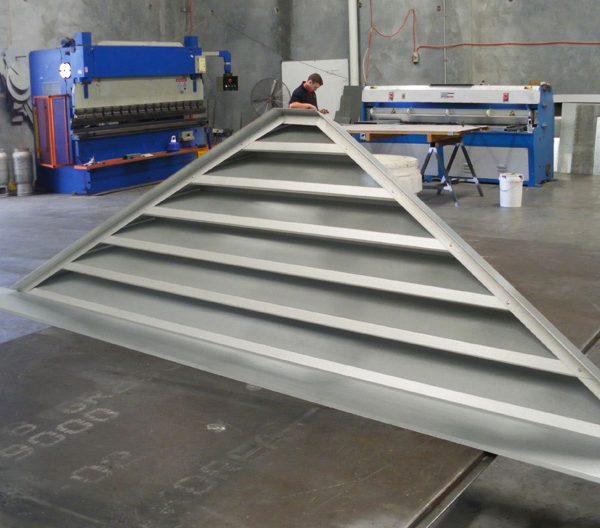 a grey triangle gable louver