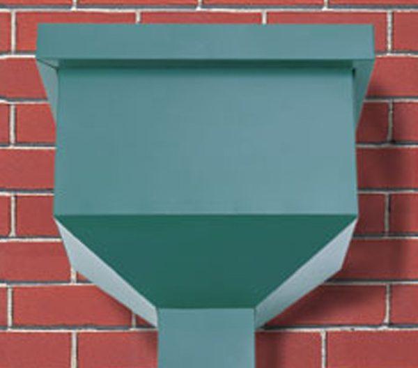 green rain heads against a brick wall